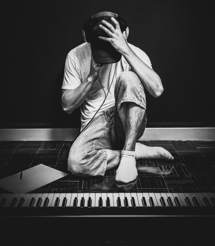 song-ideas: frustrated young man at keyboard