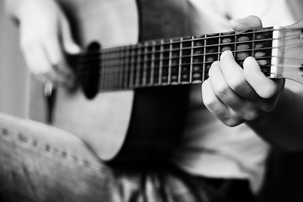 guitar player working on songwriting success