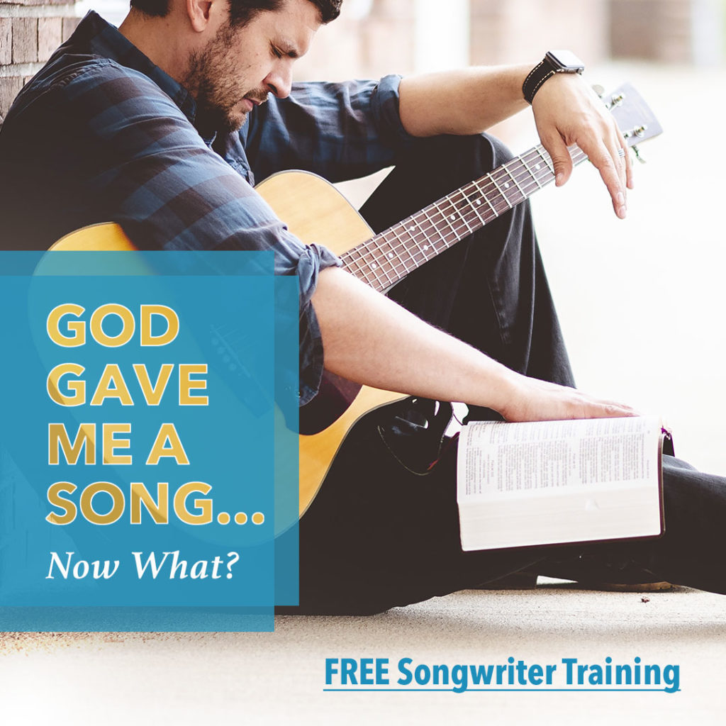 man reading Bible holding guitar