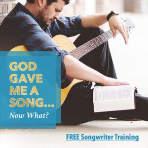 man reading Bible holding guitar